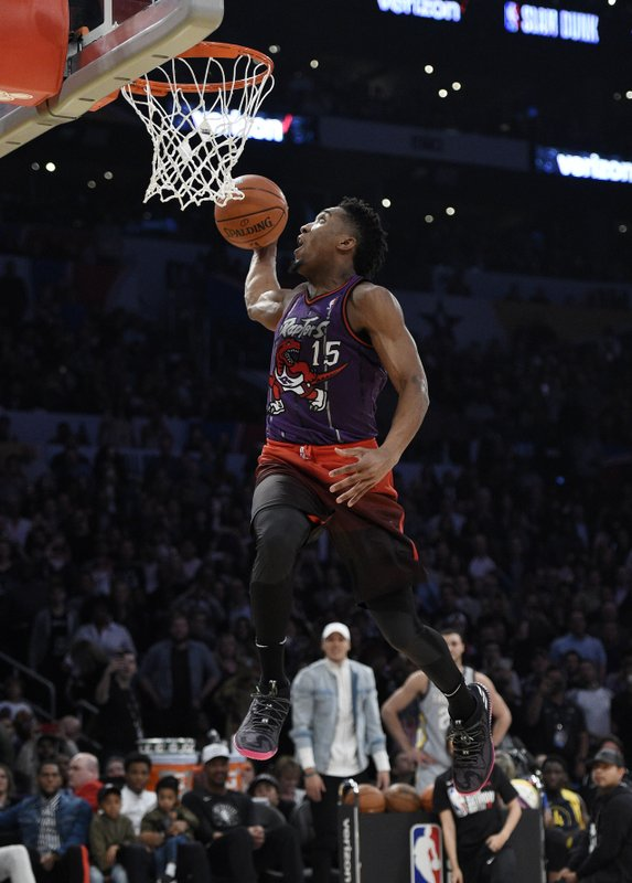 timeless design f9ec0 a6916 Donovan Mitchell soars to dunk title