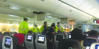 Emergency workers assist passengers on Air Canada flight AC33 after it was diverted to Hawaii. REUTERS