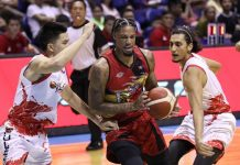 San Miguel Beermen's Chris McCullough protects the ball against the defense of Phoenix Pulse Fuel Masters' JC Intal and Alex Mallari. PBA