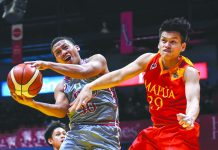 Lyceum of the Philippines' Enzo Navarro is forced to an awkward shot while being defended by Mapua University Cardinals' Jasper Salenga. TIEBREAKER TIMES PHOTO