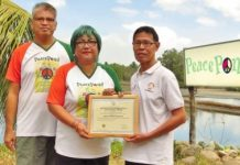 Negrense organic farmer Jesus Antonio Orbida (left) with his wife Checcs – founders of the PeacePond in Binalbagan, Negros Occidental – receive a certificate of accreditation issued by the Department of Tourism-Western Visayas. PNA