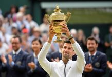 Novak Djokovic captured his 16th Grand Slam title and fifth Wimbledon, outlasting Roger Federer in the longest singles final in the tournament's history. It ended in a tiebreaker in the fifth set, a rule change this year. REUTERS