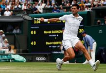 Serbia's Novak Djokovic returns against Belgium's David Goffin during their men's singles quarterfinals match of the 2019 Wimbledon Championships at The All England Lawn Tennis Club in Wimbledon, London, July 10. AFP/GETTY IMAGES