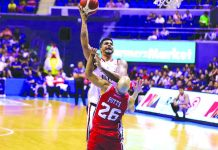 Blackwater Elite's Rabeh Al-Hussaini attacks the defense of Alaska Aces' Davon Potts for an inside hit. PBA