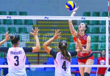 Rachel Anne Daquis of Cignal HD Spikers scores against the defense of Marinerang Pilipina Lady Skippers' Seth Rodriguez and Caitlyn Viray. PSL