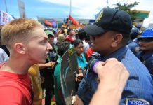 Dutch activist Thomas van Beersum confronts Filipino police officer Joselito Sevilla, who broke into tears amid a dispersal of protesters outside Batasang Pambansa during the State of the Nation Address in 2013. The foreigner was later deported. ABS-CBN NEWS