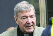Cardinal George Pell arrives at the County Court in Melbourne, Australia in this Feb. 26, 2019 photo. Pell's accuser was a 13-year-old choirboy when he alleged he was abused by then Melbourne Archbishop Pell at St. Patrick's Cathedral in December 1996 and February 1997.