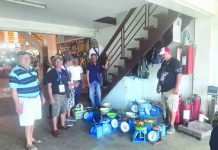 Personnel of Roxas City Environmental Sanitation and Enforcement Team seize at least 22 defective weighing scales from vendors at the Teodoro Arcenas Trade Center during a surprise inspection on Aug. 21. GLENN BEUP/PN