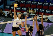 Ateneo Lady Eagles' Faith Nisperos drops an attack point against the Letran Lady Knights defenders. TIEBREAKER TIMES PHOTO