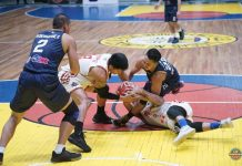 Iloilo United Royals' Al Francis Tamsi battles Basilan Steel's Chris Dumapig and Hesed Gabo for the loose ball. MPBL PHOTO