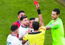 Lionel Messi of Argentina is shown a red card in the 37th minute against Chile, following a clash at the Copa America. REUTERS