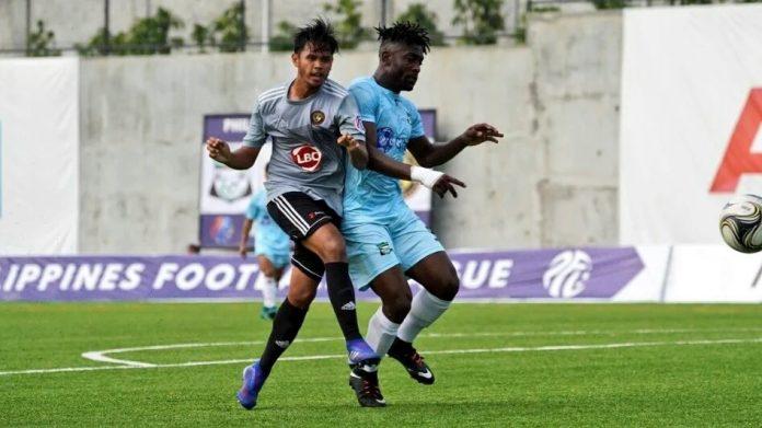 Kaya Futbol Club-Iloilo's Marwin Angeles and Green Archers United FC's Fredy Mbang try to reach the ball. KAYA ILOILO PHOTO