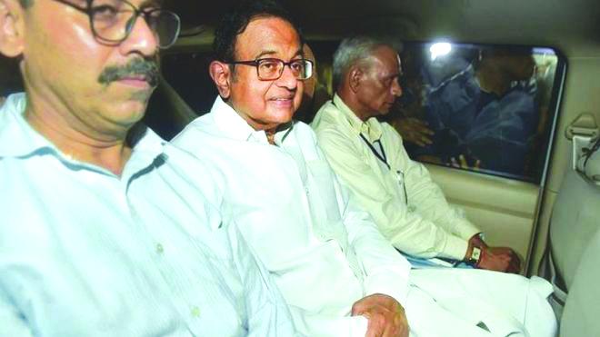 Former Indian finance minister Palaniappan Chidambaram (center) PRESS TRUST OF INDIA VIA BBC