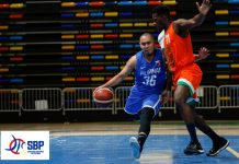 ONE ON ONE. Philippines' Paul Lee still manages to control the ball despite running into an Ivory Coast defender. CIGNAL-SBP PHOTO