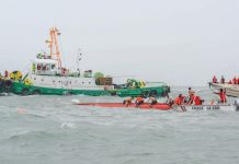 DEADLY SEA MISHAP. Coast guard officials brave the rough waters to search for victims after three motorized boats capsized off Iloilo Strait in separate incidents around noontime yesterday. According to disaster-mitigation authorities, 11 people were confirmed dead. IAN PAUL CORDERO