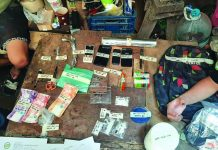 Operatives of the Philippine Drug Enforcement Agency seize these suspected shabu, cellphones, marked money, and drug paraphernalia in San Carlos City, Negros Occidental. PDEA REGION 6