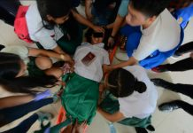 STRANGE HAPPENING. Teachers and students of Iloilo City National High School help one another restrain this high school girl who became unusually strong and uncontrollable. She was one of 11 students who behaved strangely yesterday morning, Aug. 22, 2019. Were they possessed by evil spirits? IAN PAUL CORDERO/PN