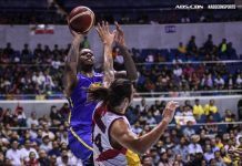 TNT KaTropa's Terrence Jones runs over the defense of San Miguel Beermen's Christian Standhardinger for an inside hit. ABS CBN SPORTS PHOTO