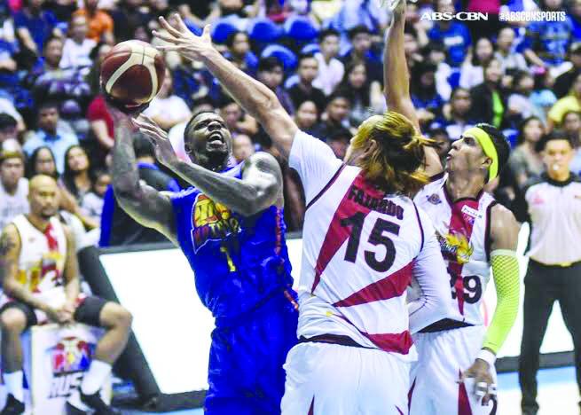 TNT KaTropa's Terrence Jones was double teamed by San Miguel Beermen's June Mar Fajardo and Arwind Santos. ABS CBN SPORTS PHOTO