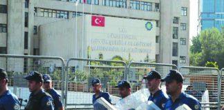 Turkish police walk in front of the Metropolitan Municipality headquarters in Diyarbakir, Turkey, Aug. 19, 2019. REUTERS