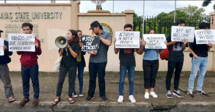 IS STUDENT ACTIVISM A CRIME? Students of West Visayas State University in Iloilo City stage a picket on Aug. 23, 2019 denouncing the planned deployment of government security forces in schools. Just this Aug. 20, students of the University of the Philippines Visayas in Miag-ao, Iloilo staged a walkout against the plan. IAN PAUL CORDERO/PN