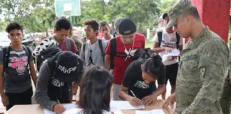 Students of Toboso National High School in Negros Occidental sign up for the Youth Leadership Summit organized by the 79th Infantry Battalion, covering the northern portion of the province, earlier this month. The activity, which is part of the Philippine Army's Community Support Program, was attended by 75 participants. PHOTO COURTESY OF 79TH INFANTRY BATTALION, PHILIPPINE ARMY