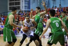 Aaron Black of AMA Online Education Titans extricates himself against the Hazchem Green Warriors defenders. PBA PHOTO