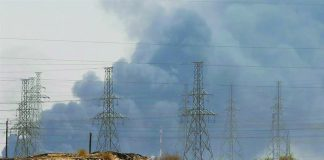 Smoke is seen following a fire at an Aramco facility in Abqaiq, Saudi Arabia, home to the world's largest oil processing plant. REUTERS