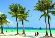 Tourists are seen in the front beach of Boracay Island in Malay, Aklan. The Department of Tourism says 95 percent of establishments in the famed-island resort are now fully compliant with its regulations. CONTRIBUTED PHOTO