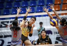 Ejiya`Laure of the University of Santo Tomas Golden Tigresses scores an attack against Arellano University Lady Chiefs defenders. ABS CBN SPORTS PHOTO