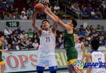 Ateneo Blue Eagles' George Isaac Go is clobbered by a Far Eastern University Tamaraws defender while trying to go for an inside basket. UAAP PHOTO