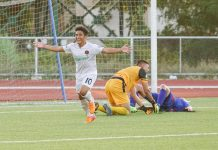 The Philippines' Justin Baas (left) attempts to chase a Guam player kicking the ball during their 2022 World Cup/2023 Asian Cup qualification on Tuesday at the Guam National Football Stadium. AFC PHOTO