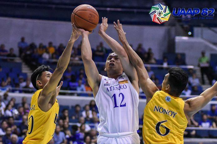 Ateneo Blue Eagles' Matt Nieto tries to get his shot up against the defense of University of Santo Tomas Tigers' Rhenz Abando. UAAP PHOTO
