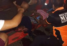 Emergency responders help one of the victims of a road crash in Miag-ao, Iloilo on Friday night. FRANCIS BASCO