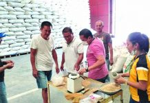 This warehouse of the National Food Authority in Barangay Bolo, Roxas City procures a total of 1,215 bags of clean and dry palay from two individual farmers and three farmer cooperatives last Sept. 13, 2019. NFA VIA PIA