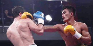 Negrense boxer Roldan Aldea connects a left straight to the face of Ravshanbek Umurzakov. RCC BOXING PROMOTIONS PHOTO