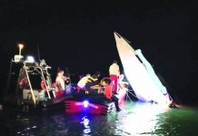 This image provided by firefighters shows the wreckage of a racing boat that allegedly smashed into a dam at the entrance of the Venice laguna, Italy, late Tuesday, Sept. 17, 2019. AP