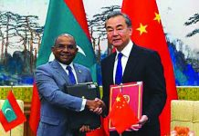 Chinese Foreign Minister Wang Yi and Foreign Minister of Maldives Abdulla Shahid shake hands and hold the signed agreements during the signing ceremony at the end of the meeting at Diaoyutai State Guesthouse, in Beijing, China Sept. 20, 2019. REUTERS