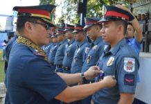 "Brigadier General Rene Pamuspusan, director of Police Regional Office 6, pins the Medal of Merit on one of the policemen who implemented successful border control and checkpoint operations in Escalante City, Negros Occidental last month. The ""Pagkilala"" awarding ceremony was held in Bacolod City on Monday. NEGROS OCCIDENTAL POLICE PROVINCIAL OFFICE"