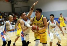 BRT Sumisip Basilan-St. Clare Saints' Alfred Batino protects the ball while being defended by Marinerong Pilipino Skippers' William McAloney. PBA PHOTO
