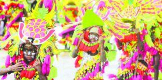 Festival dancers perform during the Santo Niño Ati-Atihan festivity. Around 71 modern and tribal Ati-Atihan groups are set for the opening salvo on Nov. 4. AKLAN FORUM JOURNAL