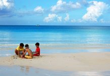 "Kids play with the famous white sand in Boracay Island, Malay, Aklan. According to Philippine Chamber of Commerce and Industry-Boracay president Elena Brugger, Filipino kids in the island are now ""influenced by the diversity of culture"" and the ""traditional cultures among them are slowly diminishing."" PHOTO FROM KEN WILSON LEE VIA FLICKR/CREATIVE COMMONS"