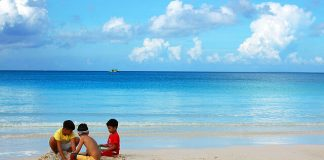 """Kids play with the famous white sand in Boracay Island, Malay, Aklan. According to Philippine Chamber of Commerce and Industry-Boracay president Elena Brugger, Filipino kids in the island are now """"influenced by the diversity of culture"""" and the """"traditional cultures among them are slowly diminishing."""" PHOTO FROM KEN WILSON LEE VIA FLICKR/CREATIVE COMMONS"""