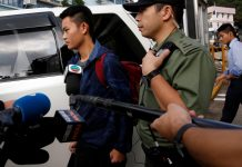 Chan Tong-kai, a Hong Kong citizen who was accused of murdering his girlfriend in Taiwan last year, leaves from Pik Uk Prison, in Hong Kong, China on Oct. 23. REUTERS/TYRONE SIU