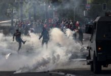 Demonstrators clash with security forces in Santiago, Chile on Saturday. AFP
