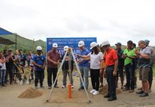 """Department of Public Works and Highways-6 regional director Lea Delfinado and Iloilo 5th Congressional district representative Raul """"Boboy"""" Tupas, along with other officials, lead the ceremonial laying capsule to commence the road concreting of Maayon-Sara Road (Iloilo) Road, Sara Section. MELVIN SEDICOL AND CHARLIE CALAPARDO"""