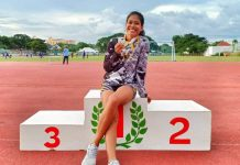 Elvy Villagoniza of Iloilo is delighted to win gold medals as a University of Santo Tomas athlete in the ongoing 24th University Games' athletics.