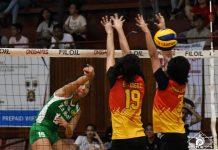De La Salle University Lady Spikers' Ernestine Tiamzon scores against a Mapua University Lady Cardinals player. USA PUBLICATIONS PHOTO