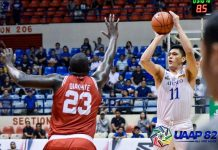 Ateneo Blue Eagles' George Isaac Go score against University of the East Red Warriors' Alex Diakhite. UAAP PHOTO