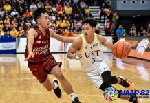 University of Santo Tomas Growling Tigers' Henri Lorenzo Subido attacks a University of the Philippines Fighting Maroons defender. UAAP PHOTO